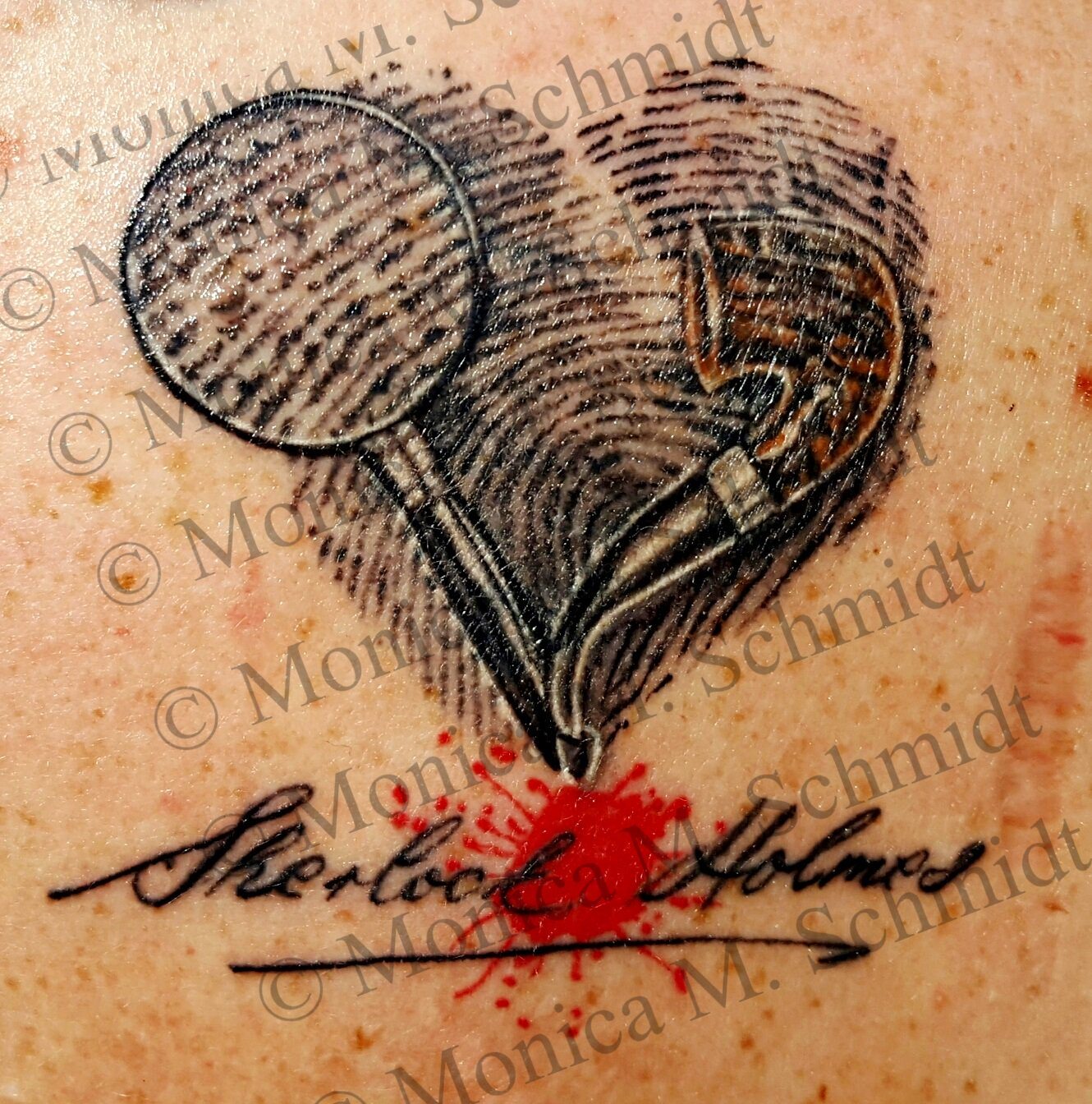 a1e2e51b6 This tattoo is on the right shoulder of Monica Schmidt. The fingerprints  are Monica's own, and the pipe is the Sherlock Holmes model from Peterson.